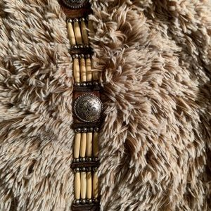 Accessories - Faux bone belt with conchoes.